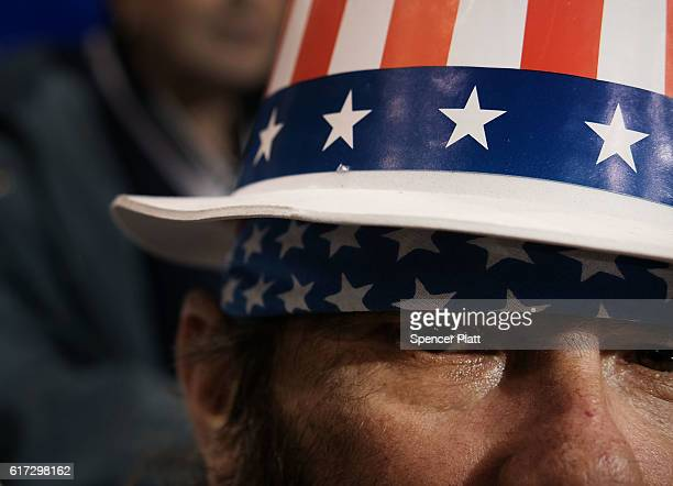 Man pauses at a Donald Trump rally on October 22, 2016 in Cleveland, Ohio.Trump continues to struggle in many swing states against his rival for the...