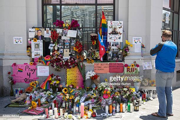 A man pauses at a makeshift vigil for those killed in the terrorist attack on a gay night club in Orlando FL on June 13 2016 in San Francisco United...