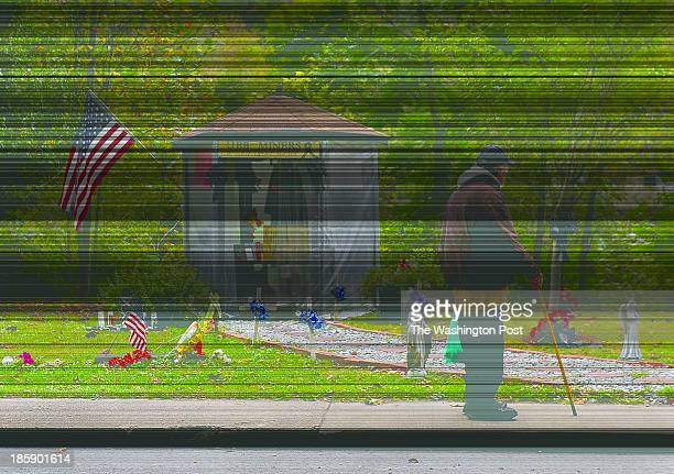 A man pauses at a roadside memorial that honors 29 miners who died at the nearby Upper Big Branch mine It still stands 6 months after the accident