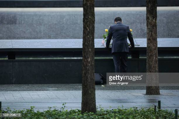 A man pauses at the north pool before the start of a commemoration ceremony for the victims of the September 11 terrorist attacks at the National...