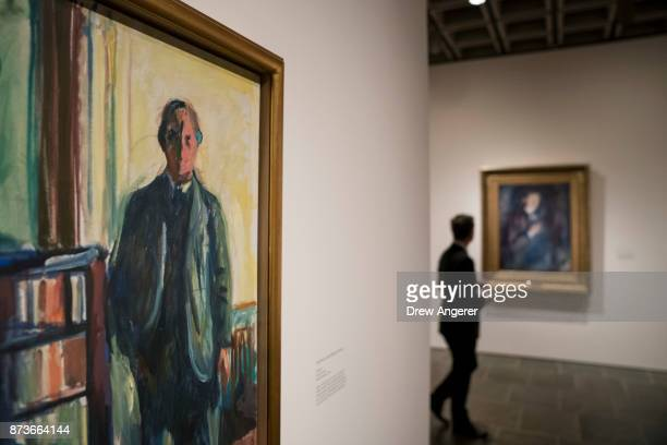 A man pauses in the selfportrait section of the Edward Munch exhibition titled 'Between The Clock and The Bed' at the Met Breuer November 13 2017 in...
