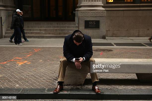 A man pauses outside of the New York Stock Exchange on January 15 2016 in New York City The Dow Jones industrial average finished down nearly 400...