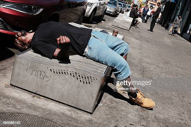 Man pauses while high on K2 or 'Spice', a synthetic marijuana drug, along a street in East Harlem on August 28, 2015 in New York City. New York,...
