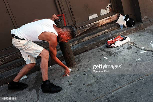 A man pauses while high on K2 or 'Spice' a synthetic marijuana drug along a street in East Harlem on August 28 2015 in New York City New York along...