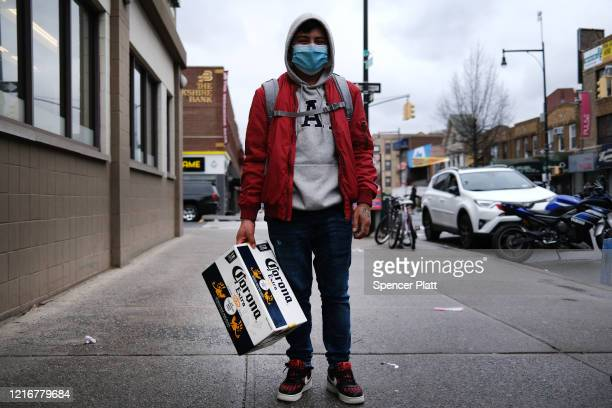 A man pauses with beer in the Borough Park section of Brooklyn which has seen an upsurge of coronavirus patients on April 03 2020 in New York City...