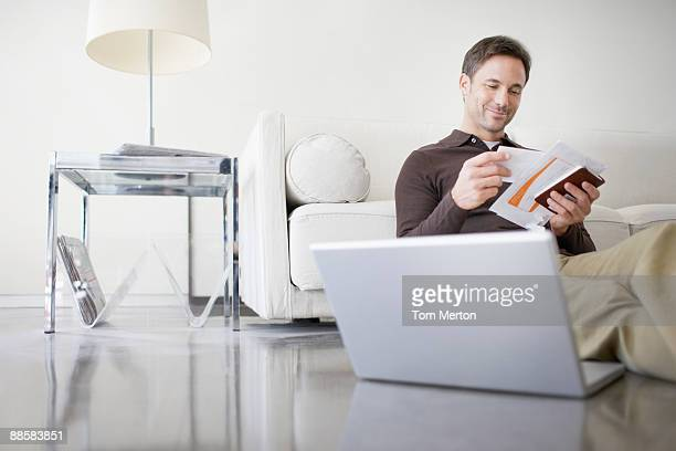 man paying bills at home - mail stock pictures, royalty-free photos & images