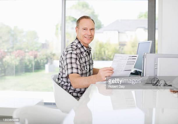 Man paying bills on computer
