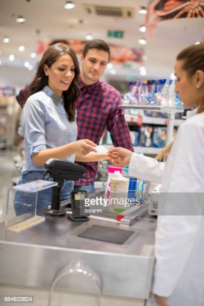 man paying contacless - convenient store stock photos and pictures