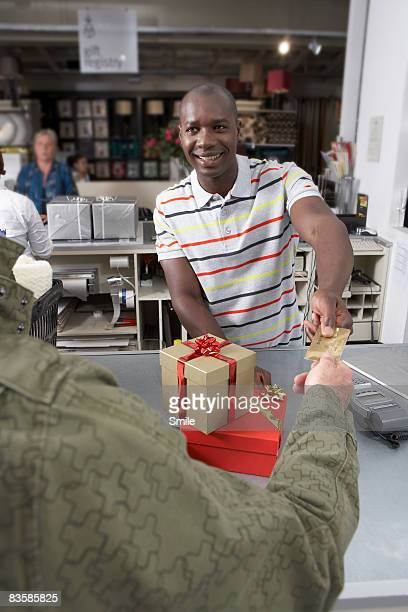 Man paying for gifts with credit card