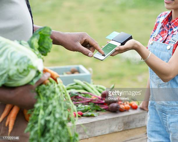 Man paying for vegetables.