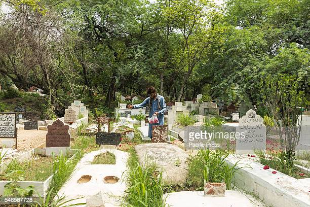 Man paying homage to late relative at a graveyards at New Delhi after the Eid-ul-Fitr prayer today morning. Eid-ul-Fitr, popularly known as Eid, is...