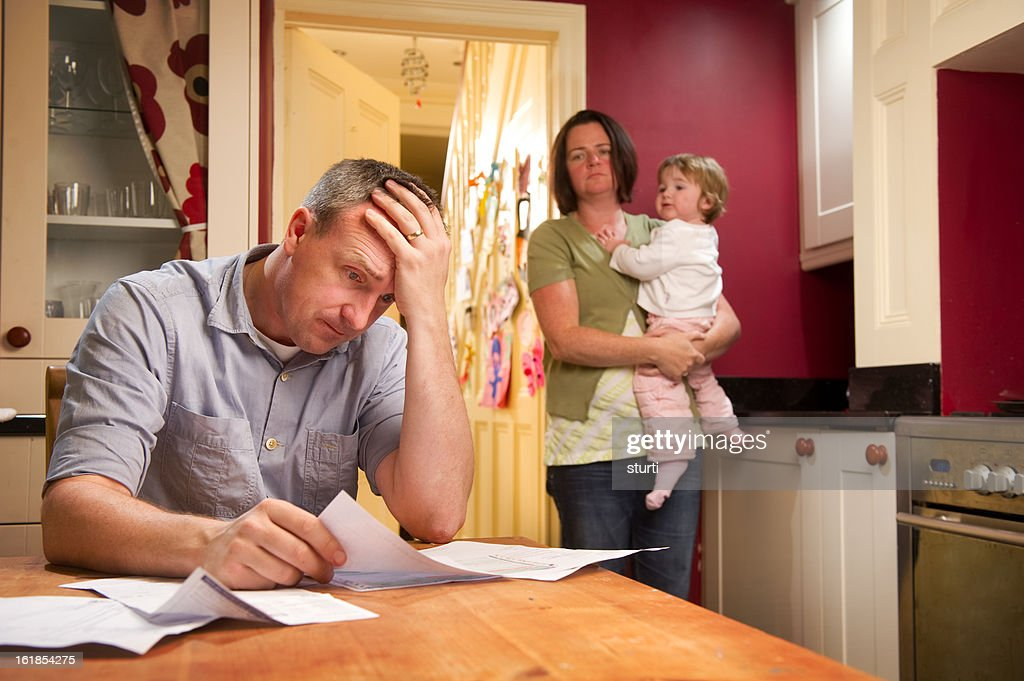 Man Paying the Bills : Stock Photo