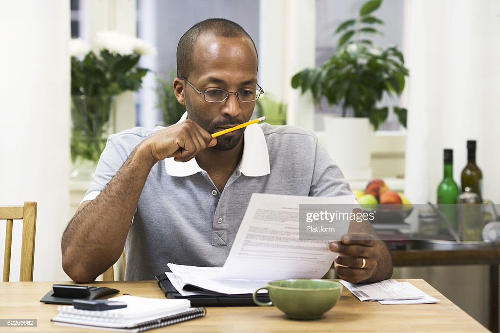 A man paying the bills Sweden. : Stock Photo
