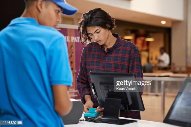 Man paying through credit card at theater
