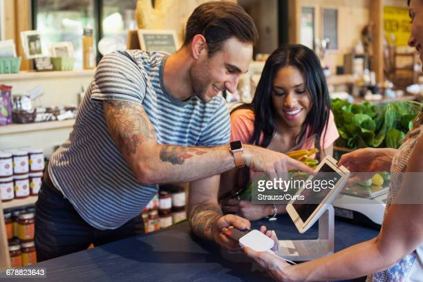 Man paying with credit card at store