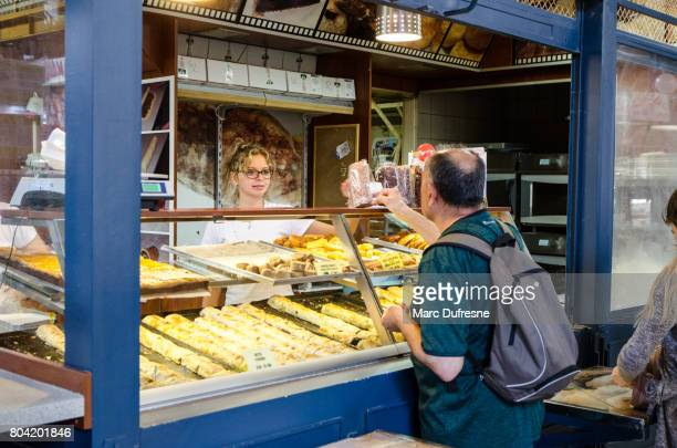 man paying woman for a pastry he bought in budapest public market - kiosk stock pictures, royalty-free photos & images