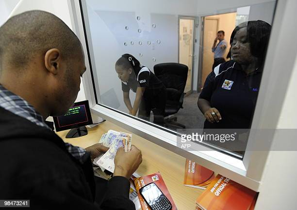 A man pays at a booking office as he purchases official 2010 FIFA World Cup tickets on April 15 2010 at the Maponya shopping mall in Soweto during...