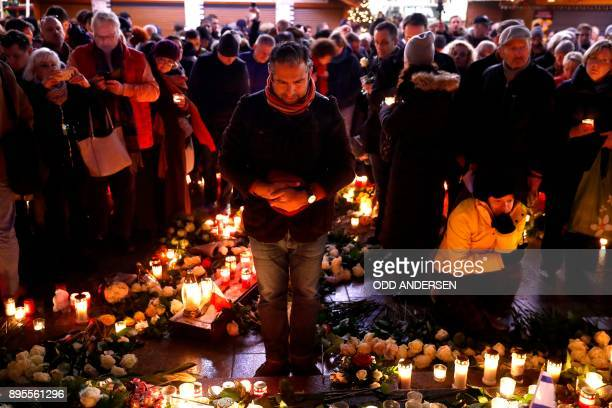 A man pays his respect at the memorial shift for the victims of the 2016 deadly truck attack at the Christmas market at Breitscheidplatz in front of...