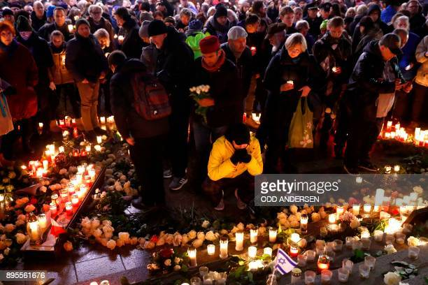 A man pays his respect at the memorial shift for the victims of the 2016 deadly truck attack at the Christmas market at Breitscheidplatz in Berlin...