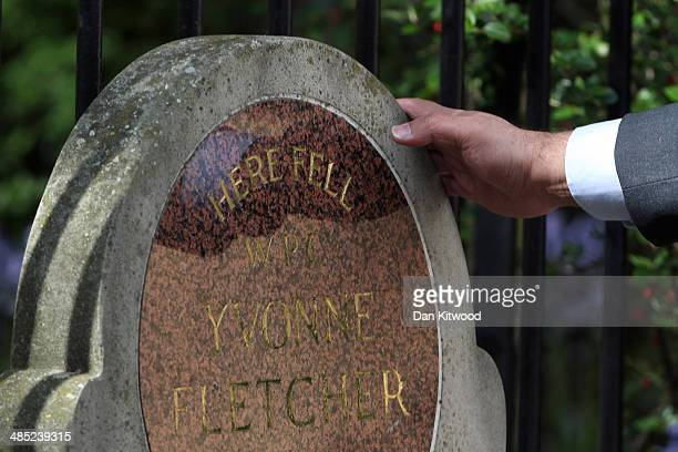 A man pays his respects after a service for the murdered Police woman Yvonne Fletcher in St James' Square on April 17 2014 in London England Sir...