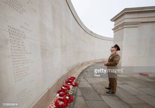 Man pays his respects at the National Memorial Arboretum in Alrewas, following a 'virtual' Act of Remembrance from the Armed Forces Memorial which is...