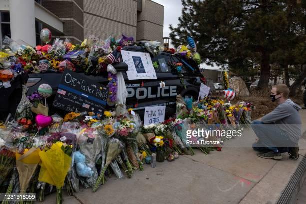 Man pays his respects to Boulder police officer Eric Talley on March 24, 2021 in Boulder, Colorado.Talley was one of 10 people killed at the King...