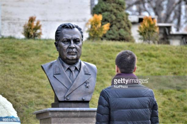 A man pays respect in front of a statue of Russian Envoy Andrei Karlov during a commemoration on the first anniversary of his death at the Russian...