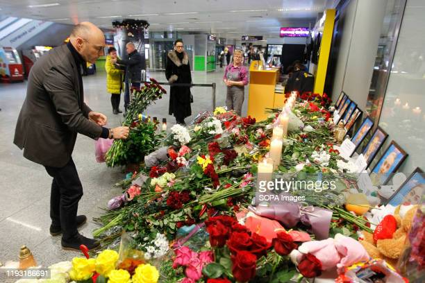 Man pays respect to the victims of flight PS 752 at the memorial corner of Boryspil International Airport. Ukrainian international airlines flight PS...