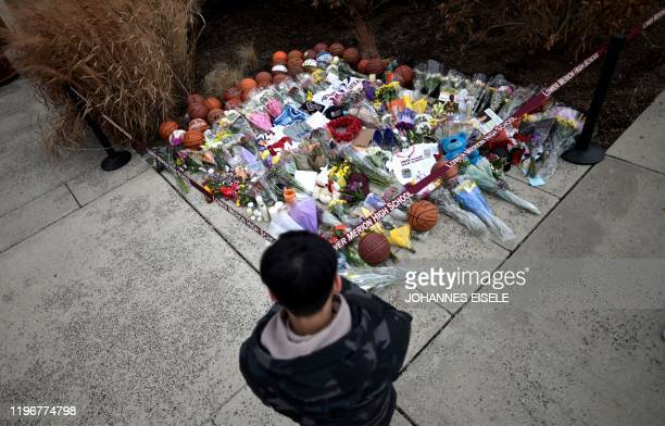 A man pays respects outside Bryant Gymnasium at Lower Merion High School where basketball legend Kobe Bryant formally attended school after his...
