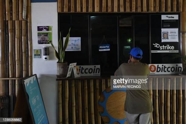 Man pays using bitcoins at a hotel in El Zonte, La Libertad, El Salvador on September 4, 2021. - The Congress of El Salvador approved in June a law...