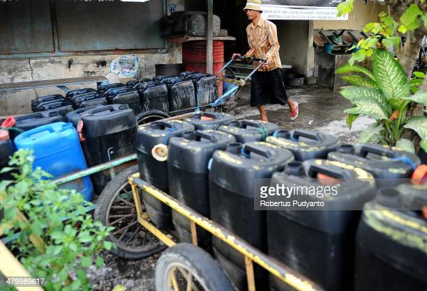A man peddles clean water on World Water Day March 22 2014 in Surabaya Indonesia World Water Day recognizes the global need for water and energy...
