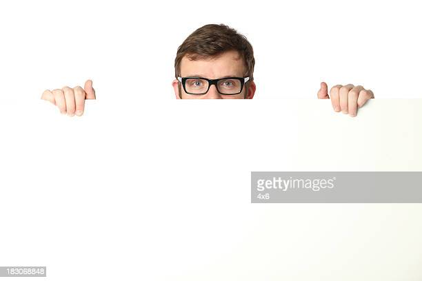 man peeking from behind a placard - blank sign stock photos and pictures