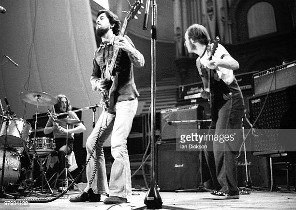LONDON Man perform live on stage at Alexandra Palace London in 1973 LR Terry Williams Micky Jones Alan 'Tweke' Lewis