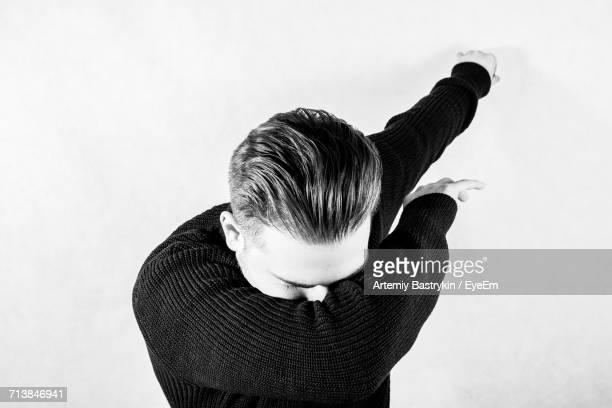 Man Performing Dab Dance Against White Background