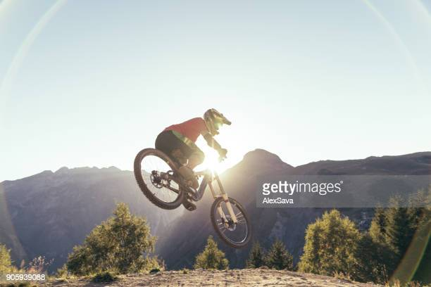 Man performing extreme stunts with mtb