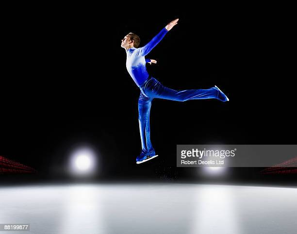 man performing, ice skating jump. - figure skating stock pictures, royalty-free photos & images