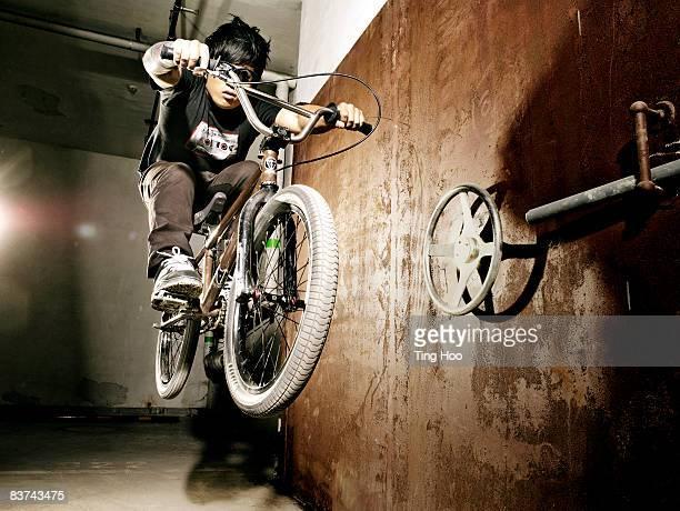Man performing jump on BMX bicycle
