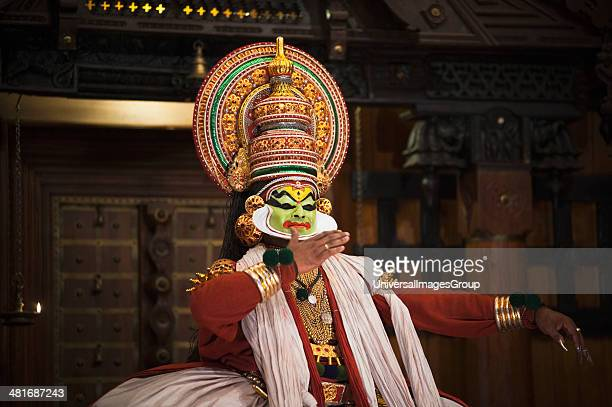 Man performing Kathakali dance Kochi Kerala India