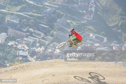 Man performing midair stunts with mountain bike