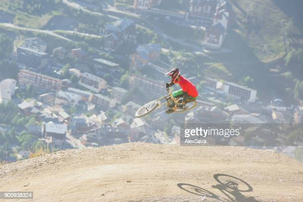 Man performing midair stunts with mountain bike