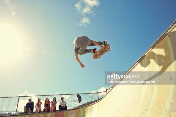 Man performing trick on skateboard at skate park