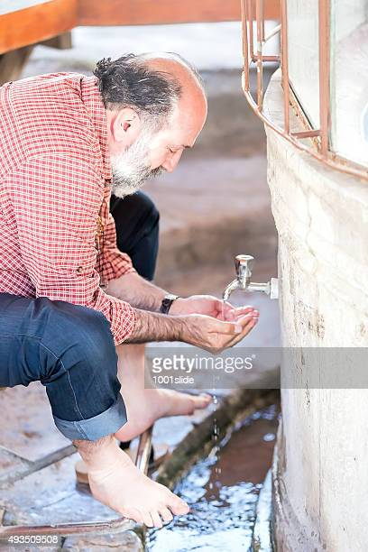 man performing wudu before pray - ceremony stock pictures, royalty-free photos & images