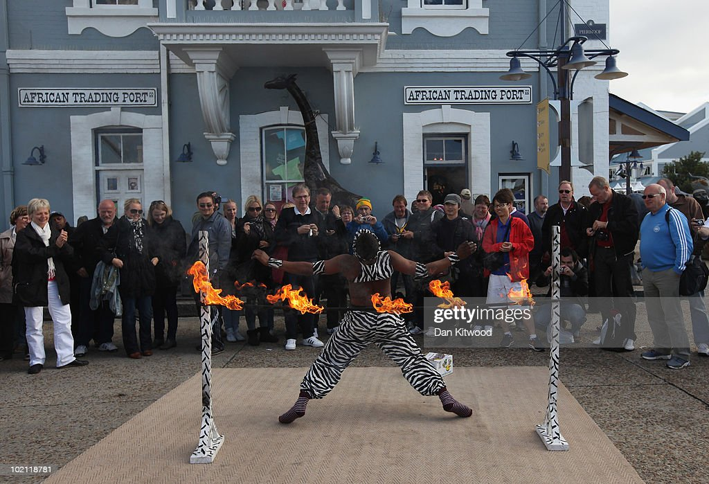 A man performs a limbo routine for tourists at Cape Town's Waterfront on June 15, 2010 in Cape Town, South Africa.