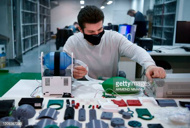 Man performs a test at a ventilator manufacturing workshop at the offices of Formon, a 3D printer manufacturer in Pristina on April 5, 2020. - Formon...