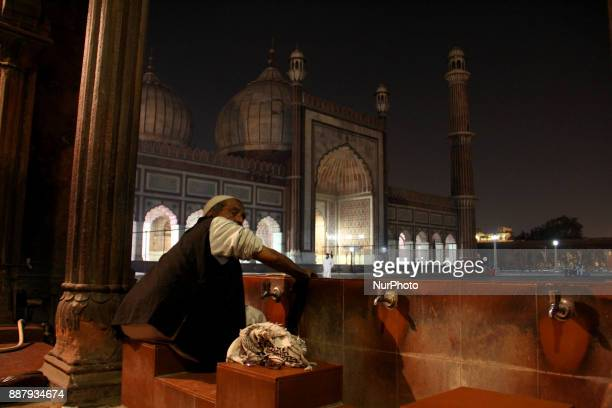 A man performs ablution before Isha prayers at Historic Jamia Masjid in Old Delhi Masjidi JahnNum commonly known as the Jama Masjid of Delhi is one...