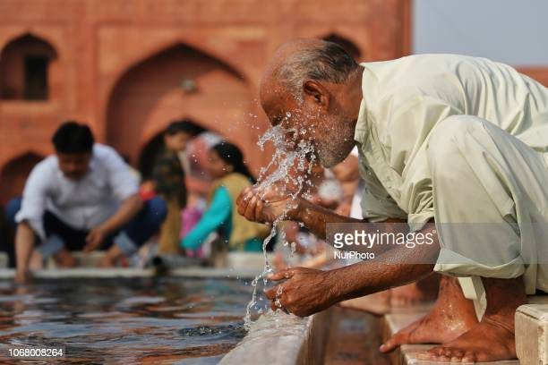 A man performs ablution before offering prayers at historic Jama Masjid in the Old Quarters of Delhi