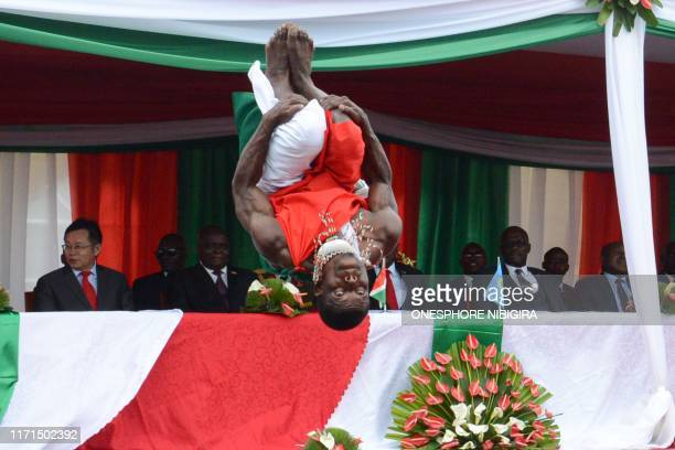 Man performs during the inauguration ceremony of the new Burundi's state house constructed by the Chinese aid in Bujumbura, on September 27, 2019.