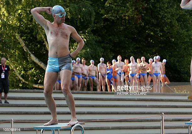A man performs in the freestyle competition of the waterballet event on the pink friday party of the Gay Games in the western German city of Cologne...