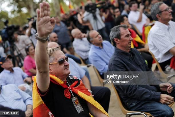 A man performs the fascist salute during an ultraright wing antiseparatist demonstration for the unity of Spain called by 'Falange Espanola' during...