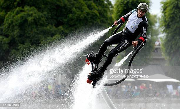 A man performs with a flyboard during the 'Red Bull Flugtag' on June 30 2013 in Stockholm Some 27 teams took part in the competition by launching...